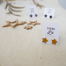 Leather star stud earrings