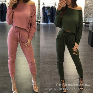 Hot Style Suit Is A Two-Piece Suit With A Broken Blouse And Tight Pants