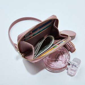 Woman Holds The Wallet Short Version Of The Version Of The Compact And Compact Portable Purse