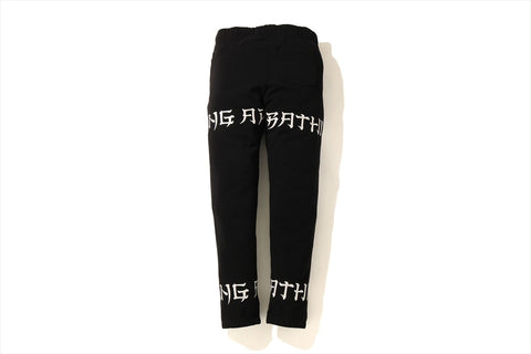 A BATHING APE LETTERED SLIM SWEAT PANTS