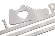 medal hanger close up image of shoe design with heart motif