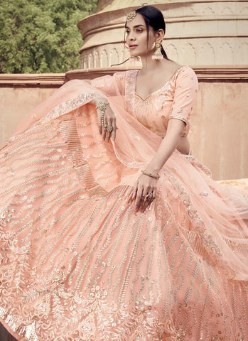 Staggering Peach Wedding Reception Lehenga Choli Net FZ43046 - Siya Fashions