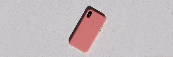 pink phone face down on table