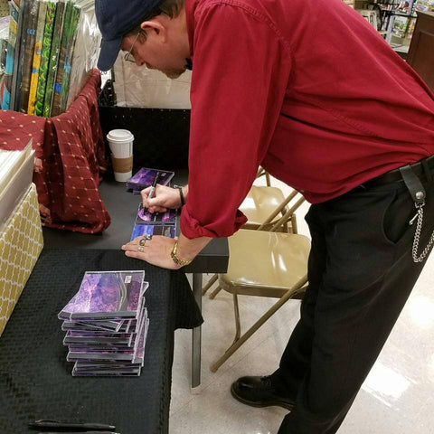 Artist Jake Hose signing music CDs
