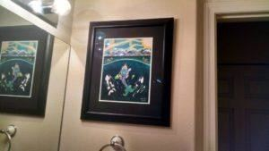 Framed whimsical artwork