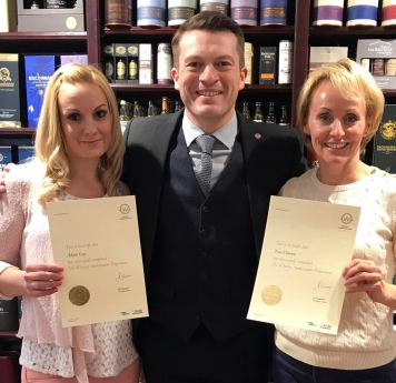 Alison and Toni being awarded their Whisky Ambassador certificates.