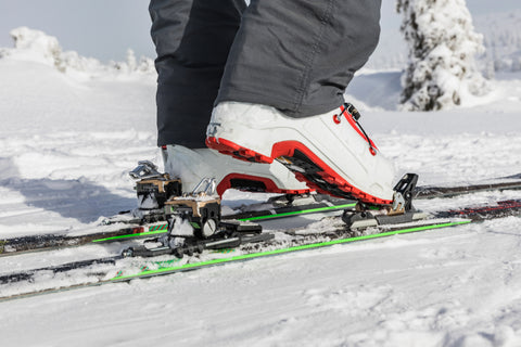 Wet Ski Boots clicking into skis on the mountain