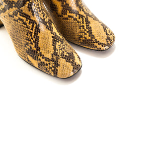 Load image into Gallery viewer, Devika Mustard Snake Ankle Boots