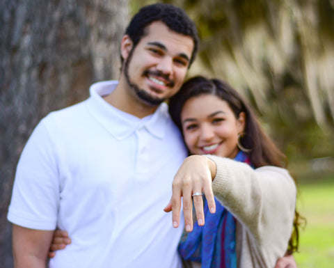 Engaged couple in Gainesville, FL showing off engagement ring