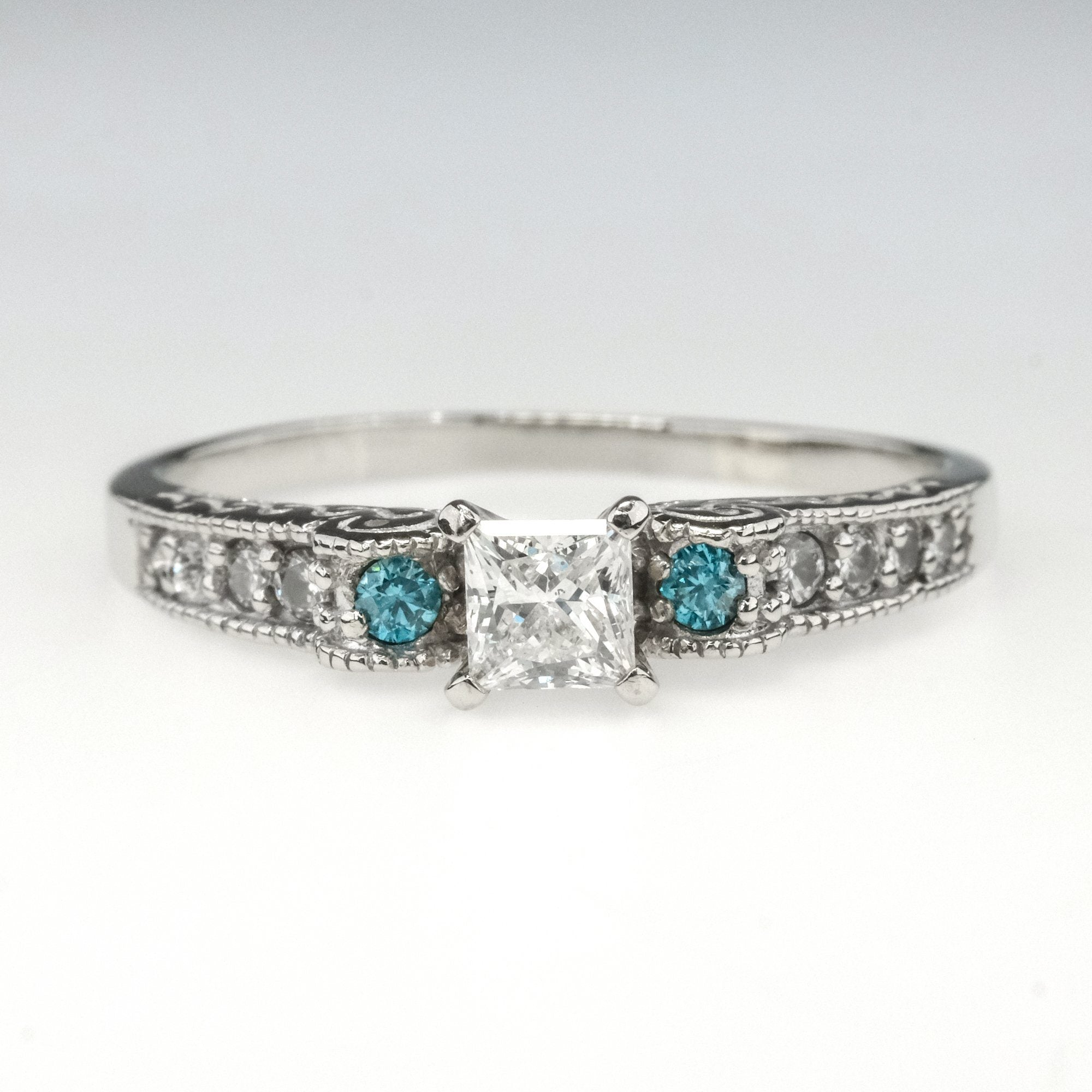 0.30CTW BLUE DIAMOND RING