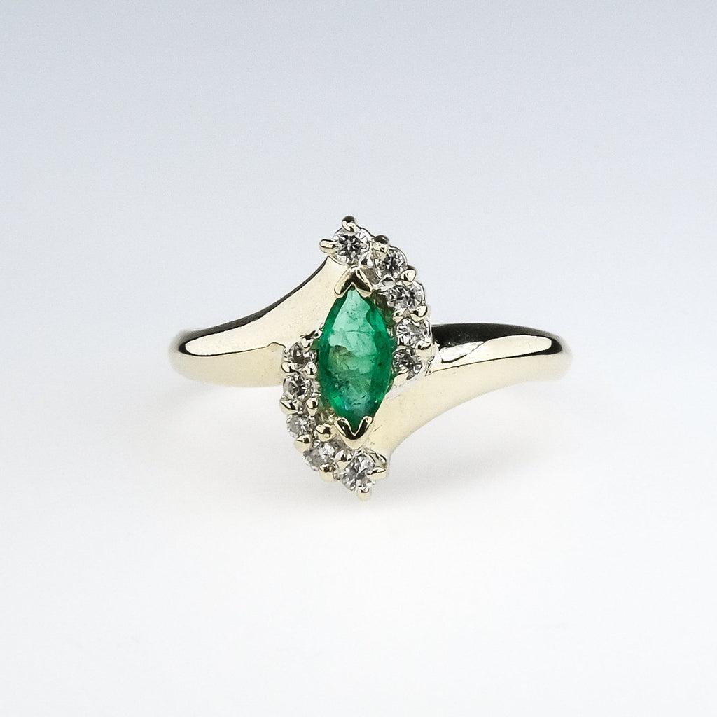 14K Yellow Gold 0.50ct Marquise Emerald & Diamond Accents Bypass Gemstone Ring Gemstone Rings Oaks Jewelry