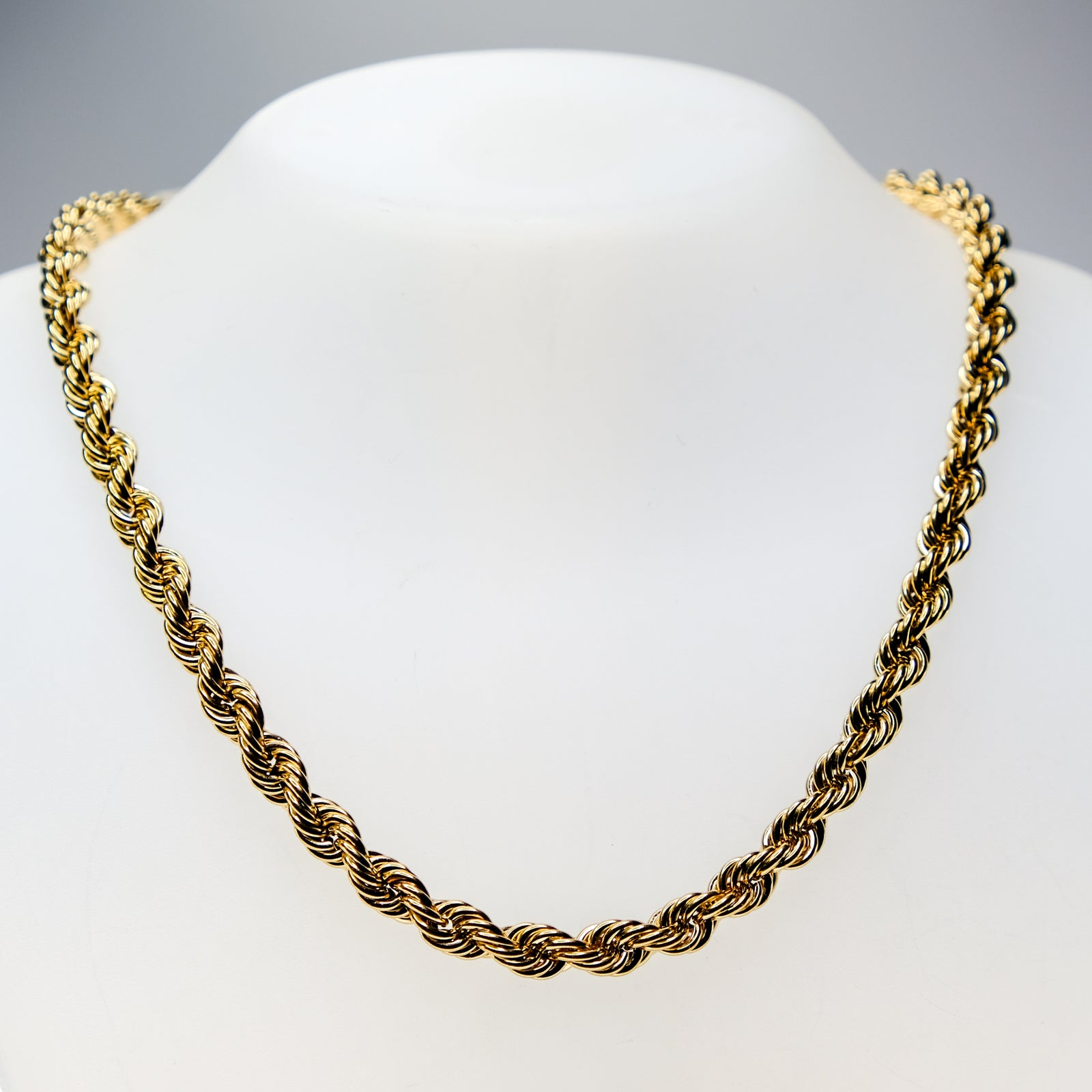 Front view of thick gold rope chain necklace