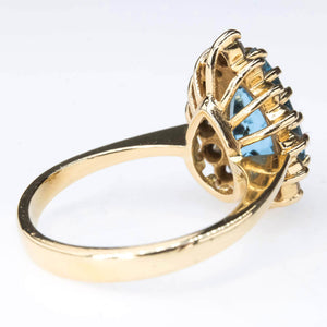 Pear Cut Blue Topaz with Diamond Halo Ring in 14K Yellow Gold Gemstone Rings Oaks Jewelry