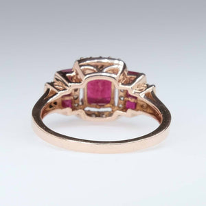 Ruby & Diamond Accented Halo Ring in 14K Rose Gold Gemstone Rings Oaks Jewelry