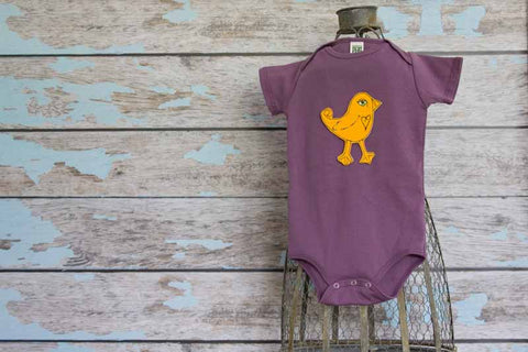 Goldenrod Bird on Eggplant organic Onesie