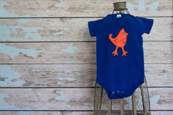 Fluorescent Orange Mohawk Bird on Electric Blue Organic Onesie