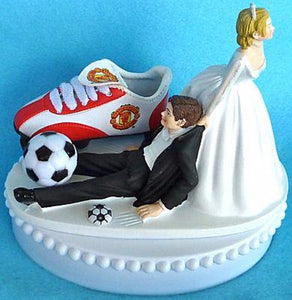 Manchester United wedding cake topper soccer Man U. groom's cake top sports fans fun bride dragging groom sporty ball cleat humorous Fun Wedding Things reception gift
