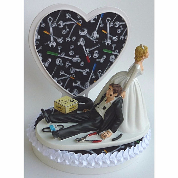 Bride dragging groom wedding cake topper mechanic grease monkey FunWeddingThings.com tools groom's cake top funny humorous heart unique original
