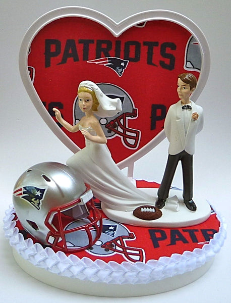 Patriots wedding cake top New England football FunWeddingThings.com NFL sports fans bride running away groom humorous unique heart pretty