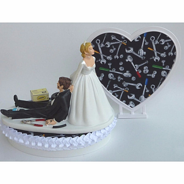 Auto mechanic wedding cake topper Fun Wedding Things grease monkey tools bride dragging groom humorous funny tools shop garage boxes heart