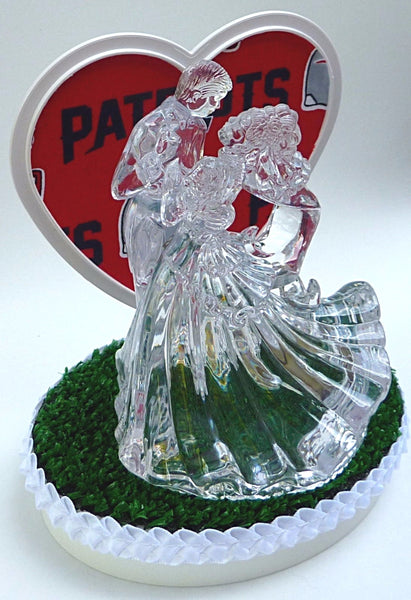 Patriots cake topper football fans FunWeddingThings.com green turf bride groom dancing