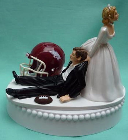 University of Arkansas Razorbacks wedding cake topper Hogs football U of A groom's cake top sports fans funny bride dragging groom humorous reception gift ball helmet Fun Wedding Things