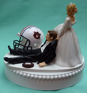 Auburn University wedding cake topper Tigers groom's cake top football college NCAA school bride dragging groom humorous funny Fun Wedding Things green turf helmet ball reception gift item idea Tigers