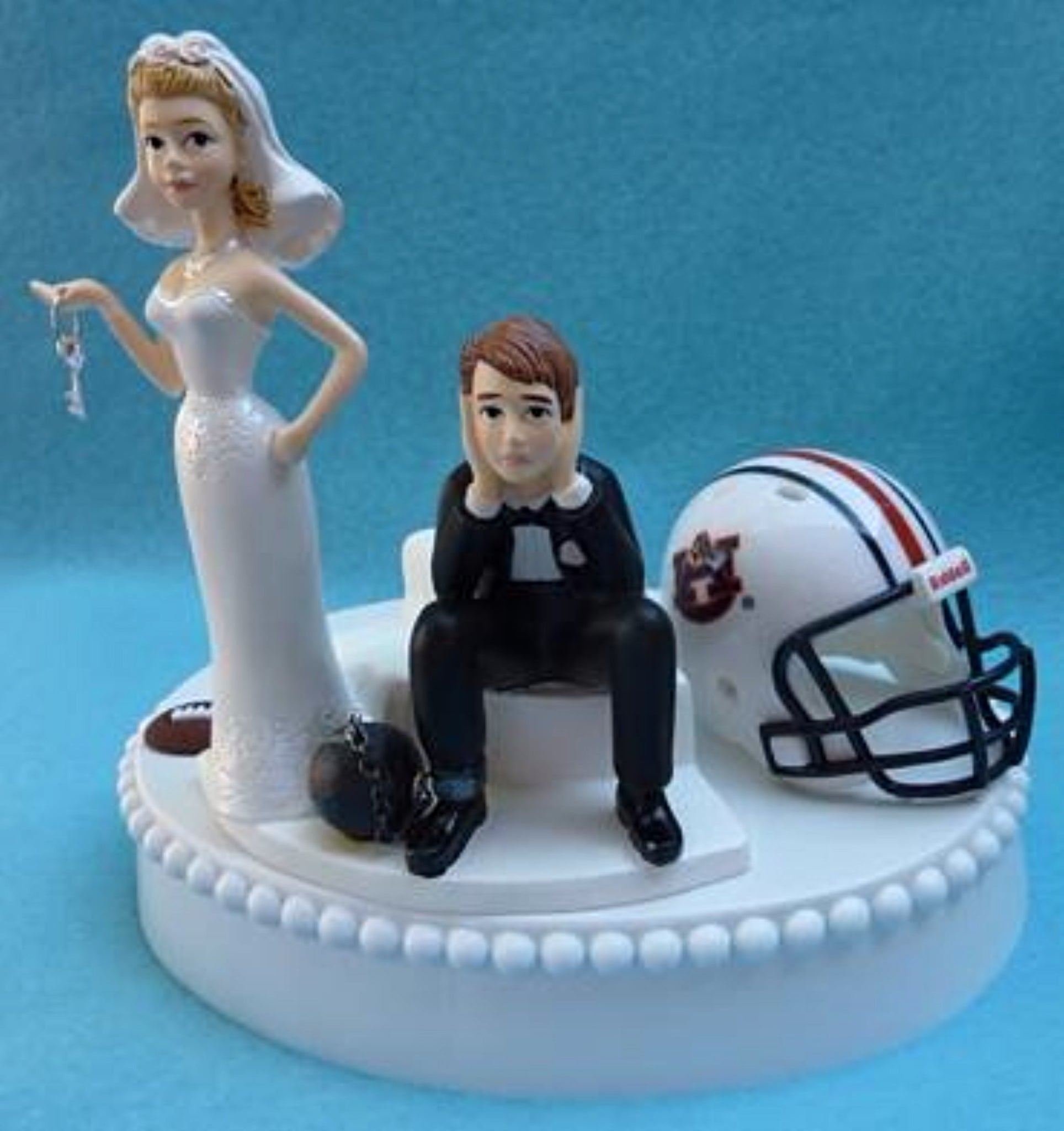 Auburn Tigers wedding cake topper football humorous groom's cake top ball chain helmet bride dejected groom key funny Fun Wedding Things
