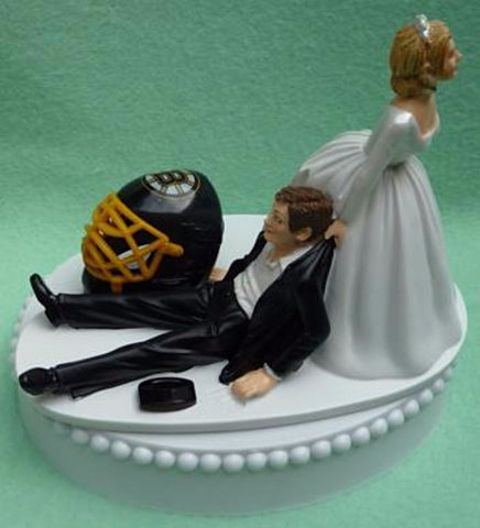 Boston Bruins cake topper wedding NHL hockey sports fans bride dragging groom humorous reception item gift idea funny Fun Wedding Things