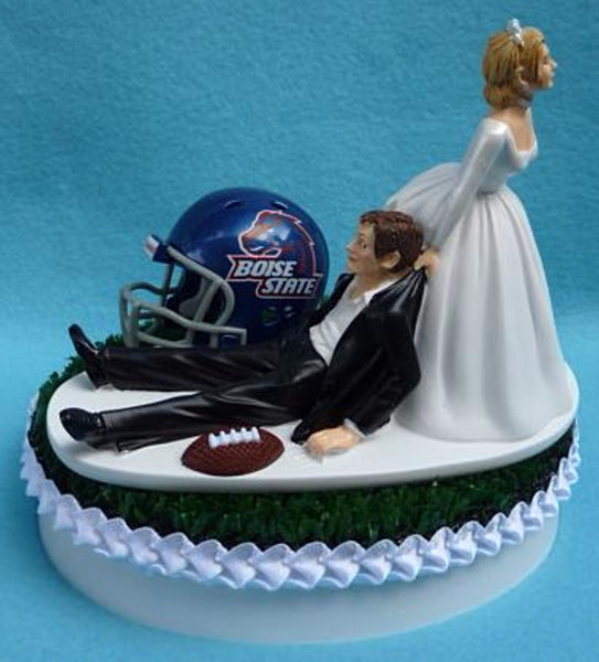 Boise St. University wedding cake topper BSU Broncos State groom's cake top football sports fans fun green turf helmet ball bride dragging groom humorous reception Fun Wedding Things