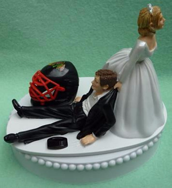 Chicago Blackhawks cake topper wedding hockey NHL sports fans funny bride dragging groom's cake top humorous Fun Wedding Things blue turf ice reception