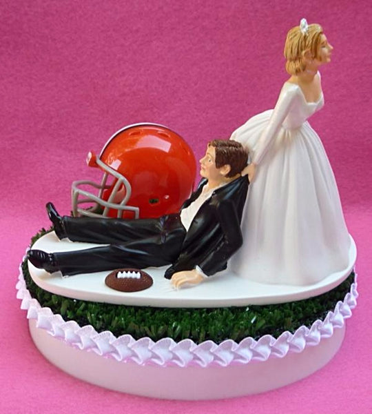 FunWeddingThings.com Cleveland Browns wedding cake topper NFL football humorous funny sports fans bride dragging groom