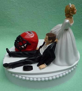 Carolina Hurricanes cake topper wedding groom's top NHL sports hockey fans bride groom dragging humorous funny Fun Wedding Things reception