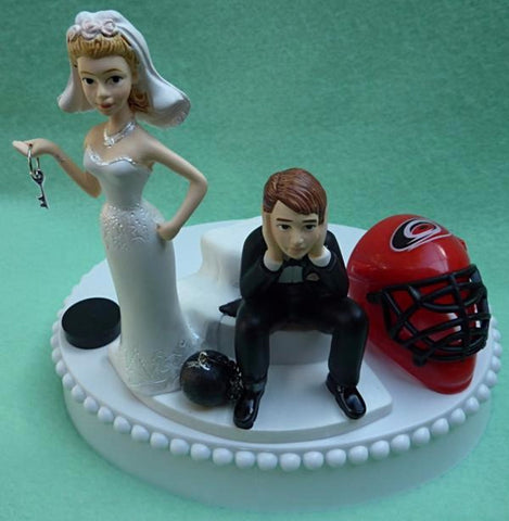 Carolina Hurricanes wedding cake topper NHL hockey Canes fun wedding things sports fans bride dejected groom humorous puck helmet mask blue ice turf reception gift