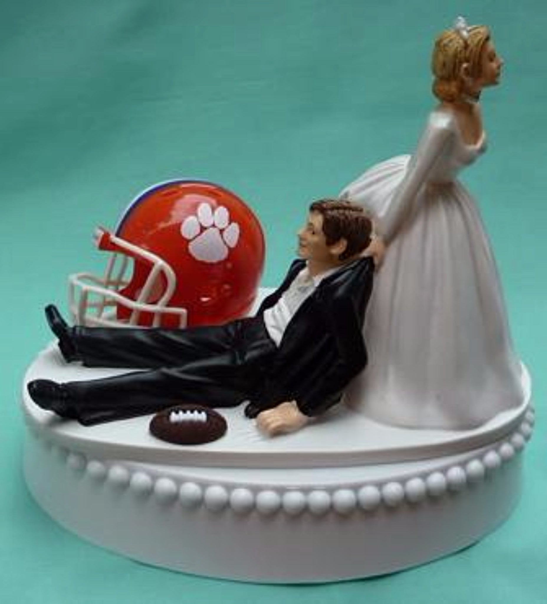 Clemson wedding cake topper Clemson University Tigers football themed sports fans fun bride dragging groom humorous reception gift FunWeddingThings.com