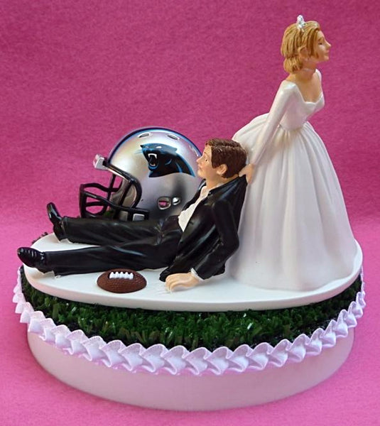 Carolina Panthers cake topper wedding NFL football FunWeddingThings.com bride drags groom humorous funny sports