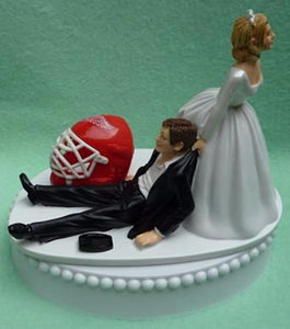 Detroit Red Wings cake topper wedding hockey groom's cake top NHL sports fans fun bride dragging groom unique original humorous Fun Wedding Things
