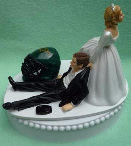 Dallas Stars cake topper wedding NHL hockey sports fans funny humorous bride dragging groom's cake top blue ice turf reception Fun Wedding Things