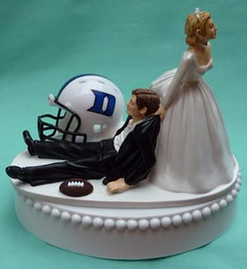Duke wedding cake topper Duke University Blue Devils football themed humorous bride dragging groom sports fans funny reception gift item idea Fun Wedding Things