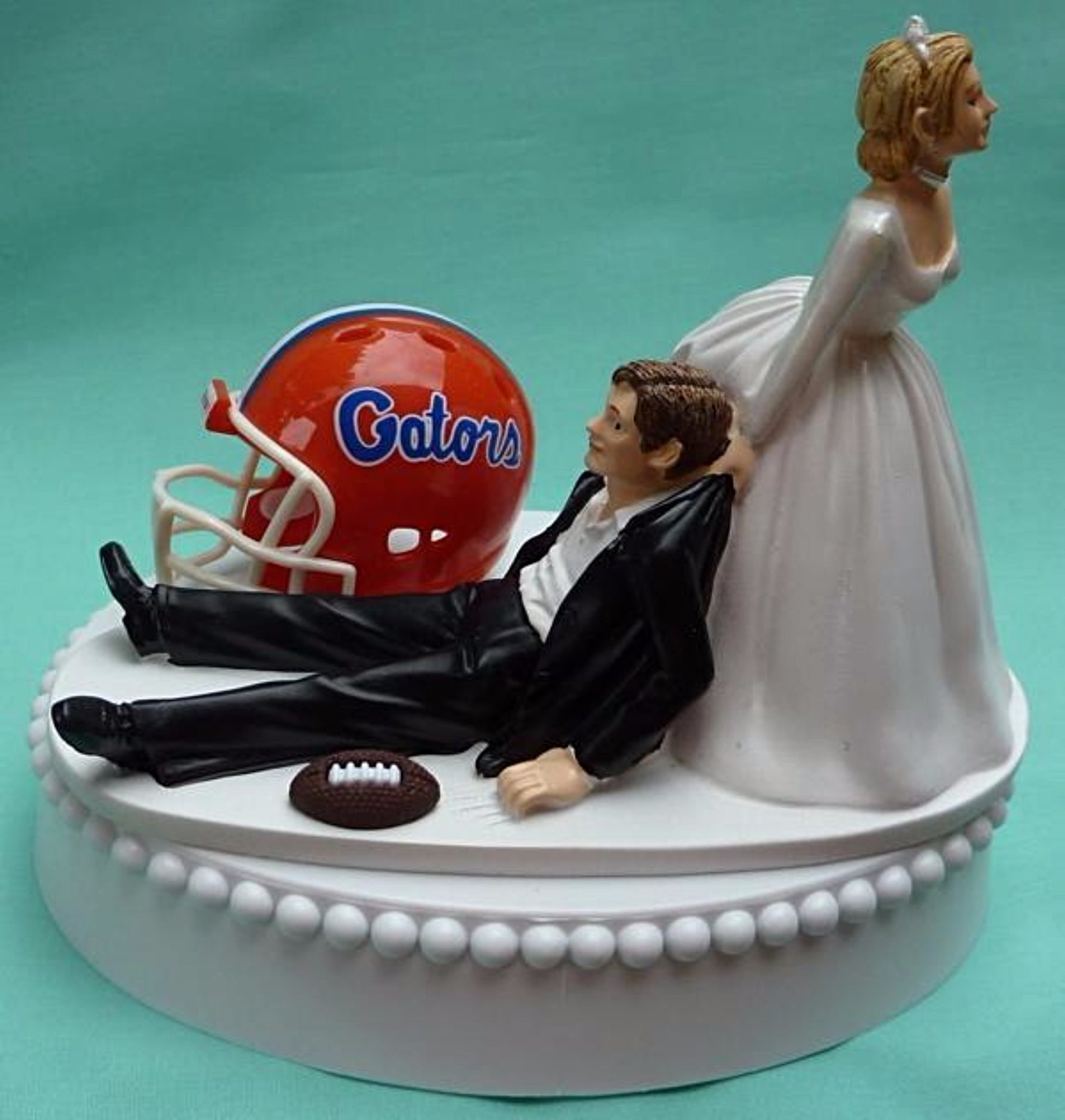 University of Florida wedding cake topper Gators UF football groom's cake top green turf ball helmet humorous bride dragging groom funny reception gift Fun Wedding Things