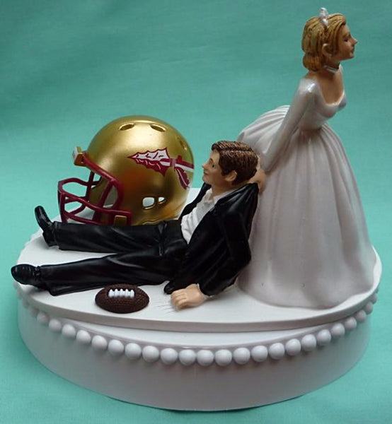 Florida St. University wedding cake topper football FSU Seminoles State Noles bride dragging groom groom's cake top humorous reception sports fans Fun Wedding Things