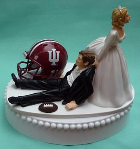 Indiana University wedding cake topper groom's cake top IU Hoosiers football themed sports fans funny humorous reception bride dragging groom helmet ball Fun Wedding Things