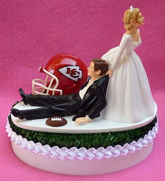 KC Chiefs wedding cake topper Kansas City football bride dragging groom humorous funny unique NFL fans sports reception