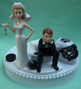 LA Kings wedding cake topper Los Angeles hockey fans NHL sports bride groom puck mask helmet blue ice humorous funny Fun Wedding Things reception
