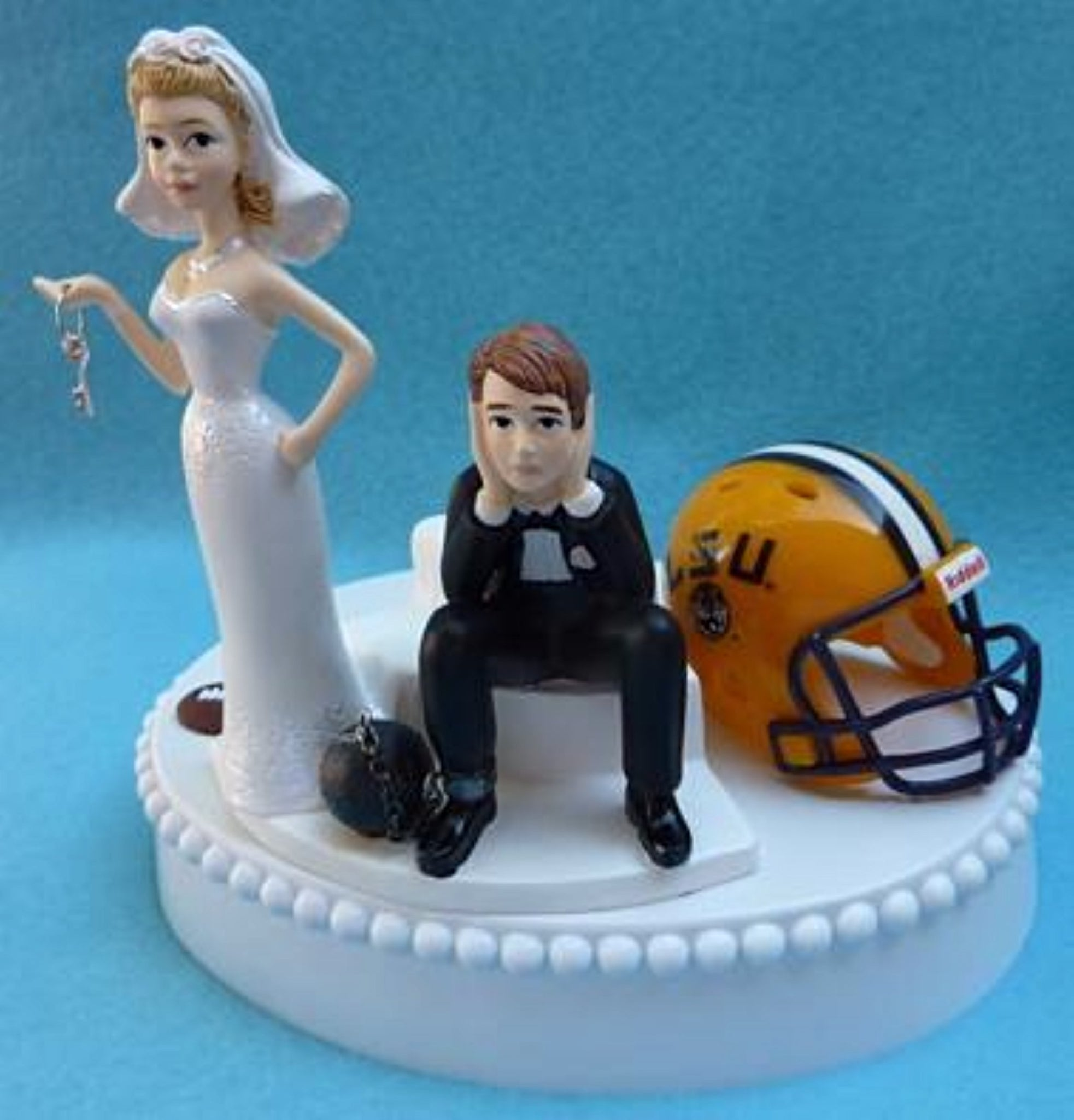 Louisiana St. University wedding cake topper LSU Tigers football funny bride sad groom ball chain key helmet sports humorous Fun Wedding Things