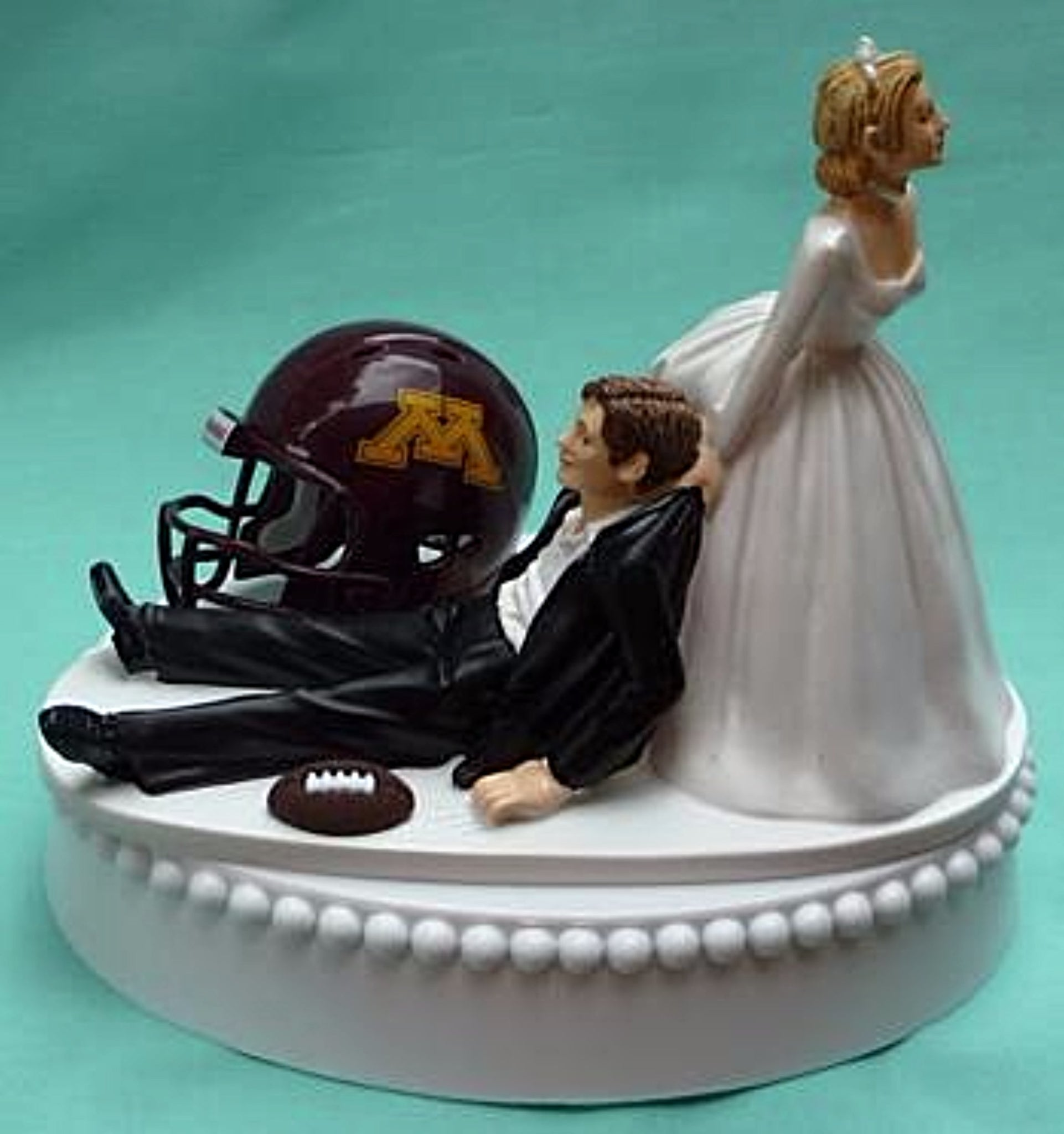 University of Minnesota wedding cake topper Golden Gophers football groom's cake top sports fans funny humorous bride drags groom reception gift Fun Wedding Things