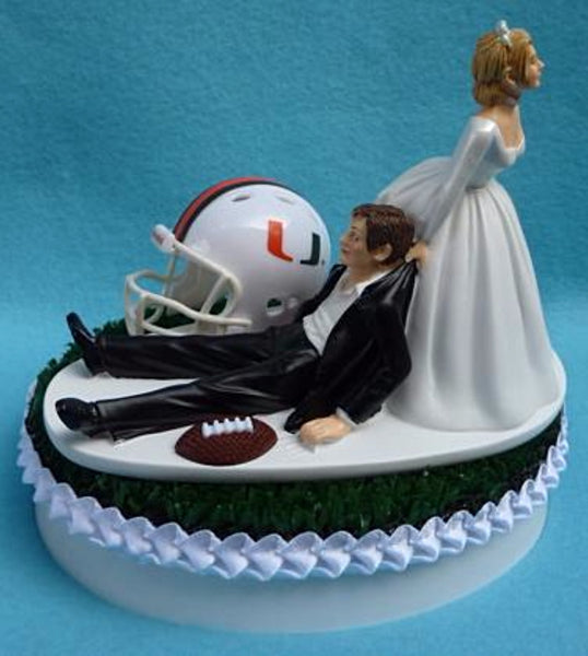 Miami Hurricanes wedding cake topper University of Miami football Canes UM groom's cake top sports fans fun bride dragging groom reception gift Fun Wedding Things humorous