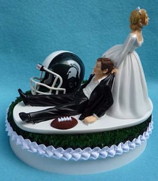 Michigan St. University wedding cake topper MSU Spartans State football groom's cake top green turf helmet ball bride dragging groom humorous sporty reception gift Fun Wedding Things
