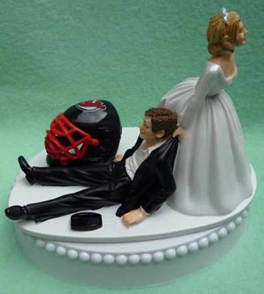 New Jersey Devils cake topper wedding groom's top NJ NHL Hockey sports fans fun humorous bride dragging reception funny Fun Wedding Things