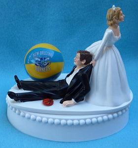 New Orleans Pelicans wedding cake topper NBA basketball sports fan funny bride dragging groom humorous Fun Wedding Things